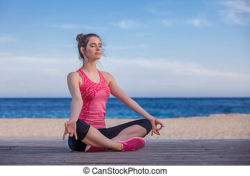 woman doing yoga or meditation outdoors