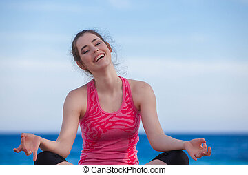 Happy woman smiling doing yoga.