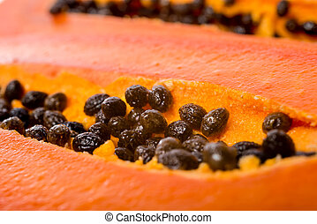 close up fresh slices papaya seeds in the fruit