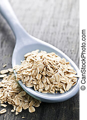 Spoon of uncooked rolled oats - Nutritious rolled oats...