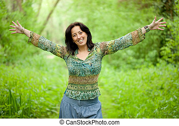 woman in nature - happy woman enjoy freedom in verdant woods