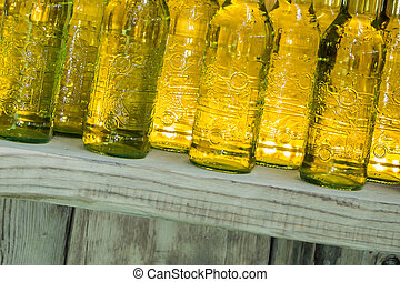 Yellow Drink Bottles on Wooden Shelf, Alcoholic aperitif