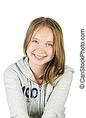 Teenage girl with earphones - Isolated portrait of beautiful...