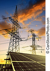 Solar panels with electricity pylons at sunset Clean energy...