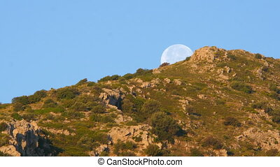 """Moon set timelapse early morning, blue sky, day"""