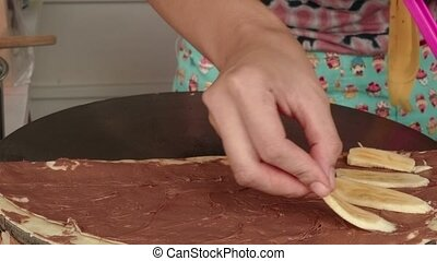 Woman making pancake with chocolate - Tasty pancake on the...