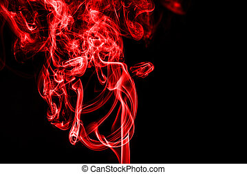red smoke on black background with copy space
