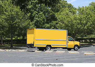 Yellow Box Truck - Yellow box truck with blue sky and trees