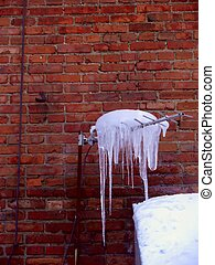 Icicles. Spring. - Icicles hanging from a roof of the brick...