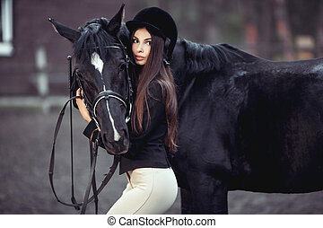 Woman and Horse in Riding School - Beautiful young girl...