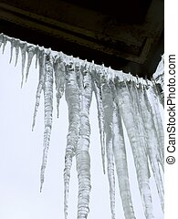 Icicles Spring - Icicles hanging from a roof against the sky...