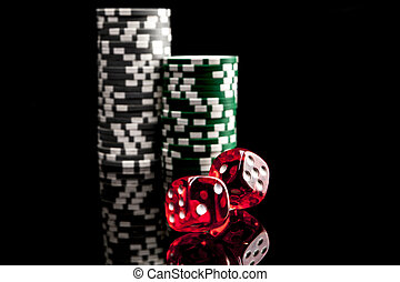 Rolling the Dice - Dice and chips isolated on black...