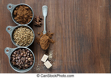 Different types of coffee on a wooden background - Coffee...