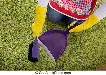 Carpet cleaning with brush and dustpan - Top view of womans...