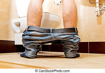 Man peeing in toilet at home