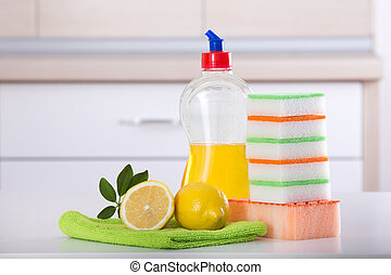 Dish washing concept. Close up of lemon and sponges for...