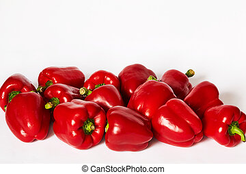 Many paprika are on a white background