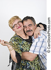 Happy mature couple embracing