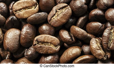 Dolly passing by coffee beans background.