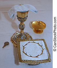 Golden Chalice with wine in the altar of a Christian Church...