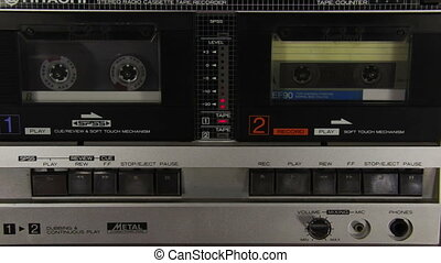 Pushing a Finger Play and Stop Button on a Two Decks Tape...