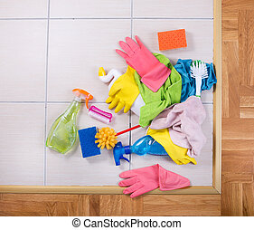 Cleaning supplies on the floor - Cleaning supplies on a pile...