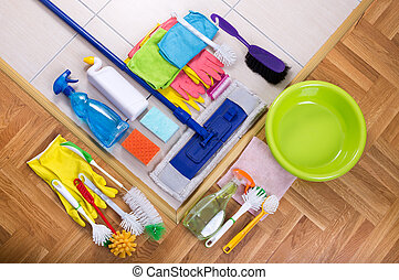 Cleaning supplies on the floor - Cleaning supplies on tiled...