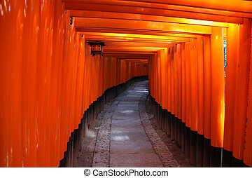 Inside the tunnel of Japanese Torii Gates at Fushimi Inari...