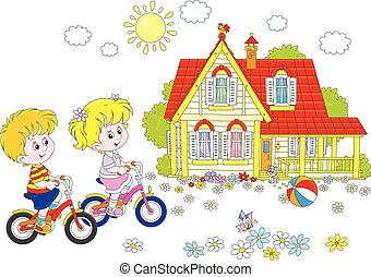 Children riding bicycles - A little girl and a little boy...