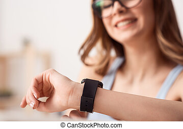 Cheerful girl wearing her wrist watch - Mind your time....
