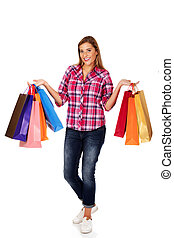 Young smiling woman holding shopping bags.