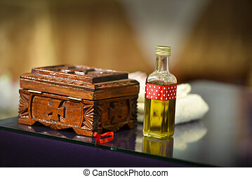 Bottle of Christening oil in a church