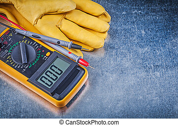 Digital electrical tester test leads pair of safety gloves on me