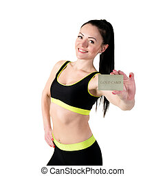 Smiling young brunette woman showing gold credit card -...