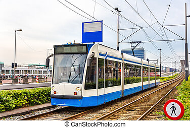 Tram in Amsterdam - A tram driving in Amsterdam - the...