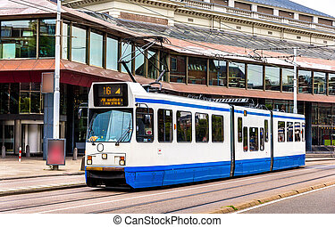 Old tram in Amsterdam - A tram driving in Amsterdam - the...