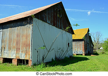 Old country buildings - Two old country buildings against a...