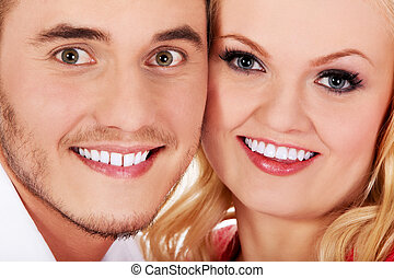 Closeup portrait of  beautiful young couple.
