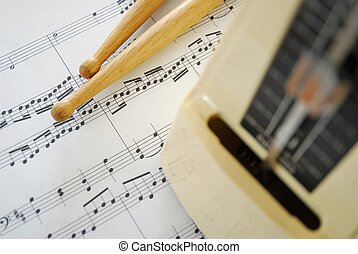 Music score, drum sticks and metronome. For concepts such as...