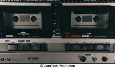 Insert Audio Cassettes into the Tape Player and Pushing...