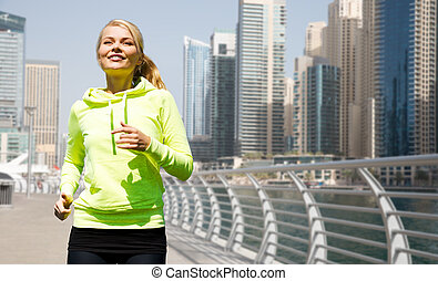 happy young woman jogging outdoors - fitness, sport, people...