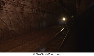 Trolley in the mine goes on rails - Underground mine iron...