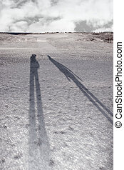 shadows on a white snow covered links golf course
