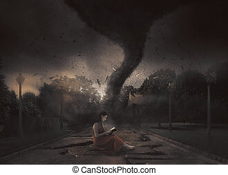 Tornado Bible study - A woman reads her Bible in the midst...