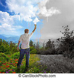 Painting the landscape - A man paints colors onto the sky...