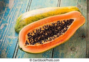 Fresh papaya on wooden background, close-up.