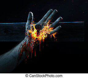 Crucified with fire - Hand of Jesus crucified with blood and...