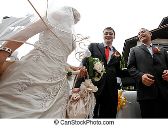 Wedding ceremony - Groom and his best man taking the bride...