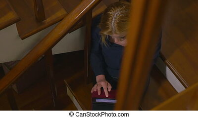 High angle view of a young attractive woman using a tablet...