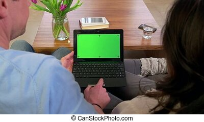 Green Screen Monitor Pc Computer - Married couple using...